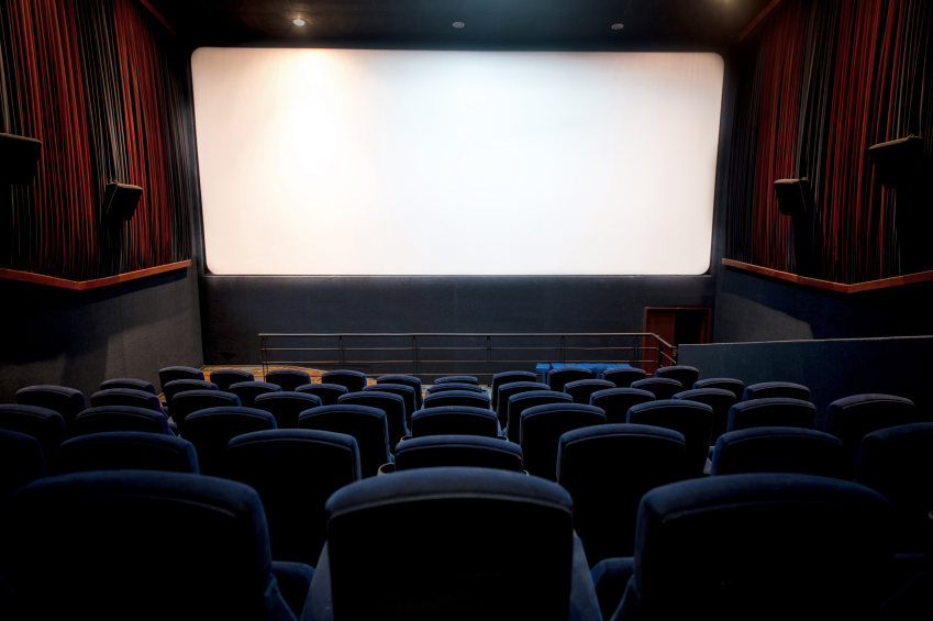 Empty movie theatre with a blank screen
