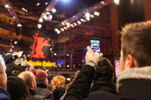 BERLIN, GERMANY - FEBRUARY 08: People watching the red carpet walk during 65th Berlinale International Film Festival at Berlinale Palace on February 8, 2015 in Berlin, Germany.